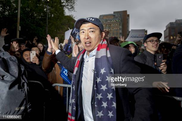 Andrew Yang founder of Venture for America and 2020 Democratic presidential candidate high fives a supporter during a campaign rally in New York US...