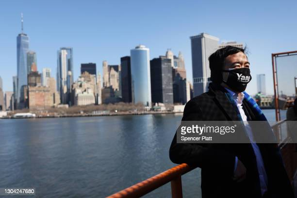 Andrew Yang, who is currently leading the contenders in his Democratic primary run for mayor of New York City, rides the Staten Island Ferry during a...