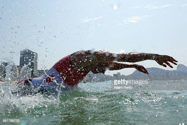 Andrew Yorke of Canada dives into the water during the Men's Triathlon at Fort Copacabana on Day 13 of the 2016 Rio Olympic Games on August 18, 2016...