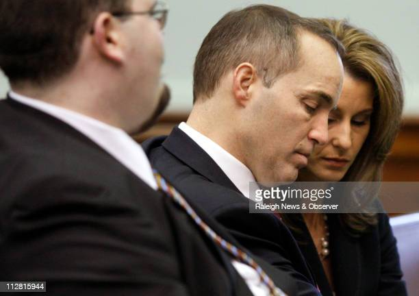 Andrew Young center and his wife Cheri Young appear before Superior Court Judge Abraham Penn Jones in Pittsboro North Carolina Friday February 5 2010...