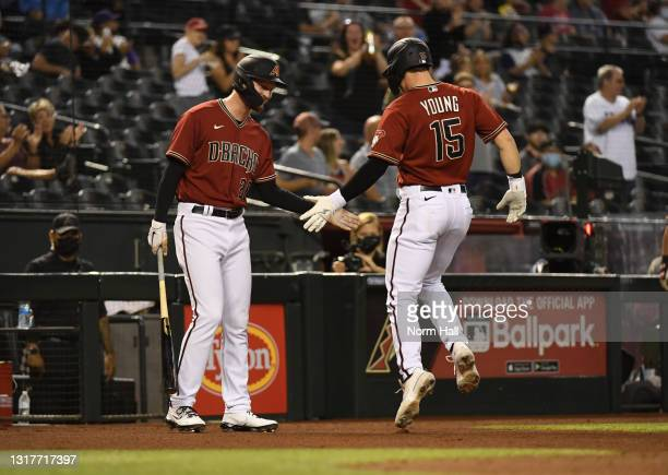 Andrew Young of the Arizona Diamondbacks celebrates with Pavin Smith after hitting a pinch hit solo home run against the Miami Marlins during the...