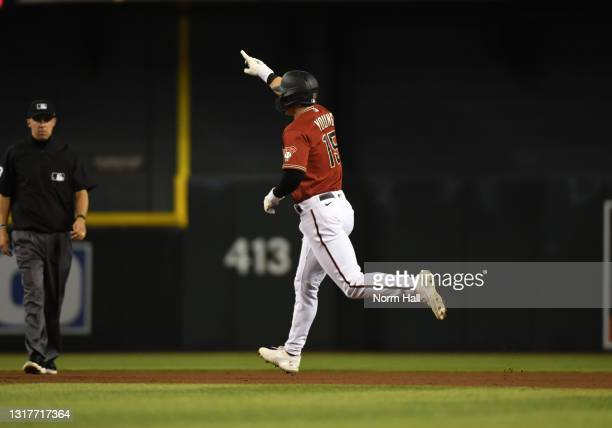 Andrew Young of the Arizona Diamondbacks gestures to the stands after hitting a pinch hit solo home run against the Miami Marlins during the fifth...