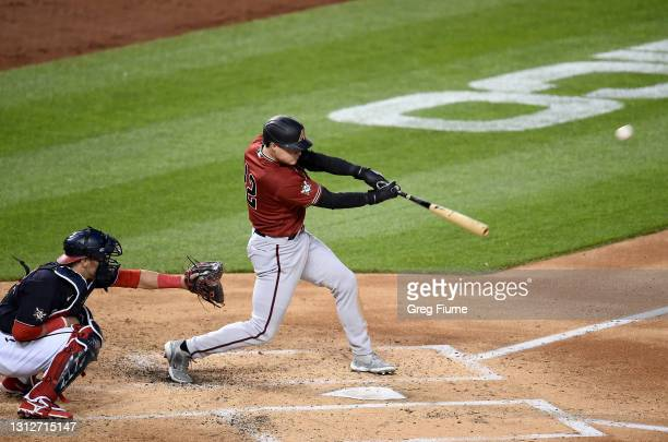 Andrew Young of the Arizona Diamondbacks hits a grand slam in the second inning against the Washington Nationals at Nationals Park on April 15, 2021...