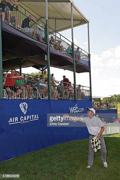 Andrew Yun tosses gifts to the crowd on the 17th hole during the third round of the Webcom Tour Air Capital Classic presented by Aetna at Crestview...
