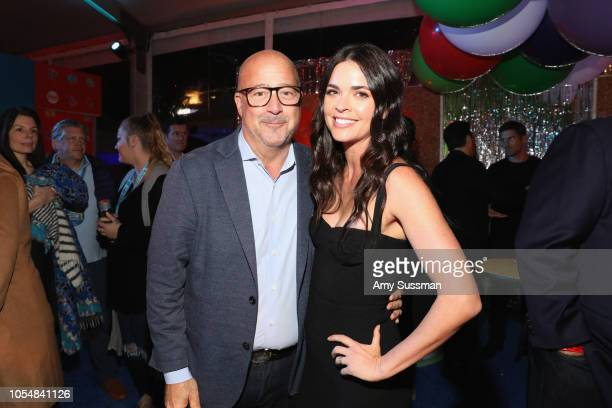 Andrew Zimmern and Katie Lee attend Food Network's 25th Birthday Party Celebration at the 11th annual New York City Wine Food Festival at Pier 92 on...