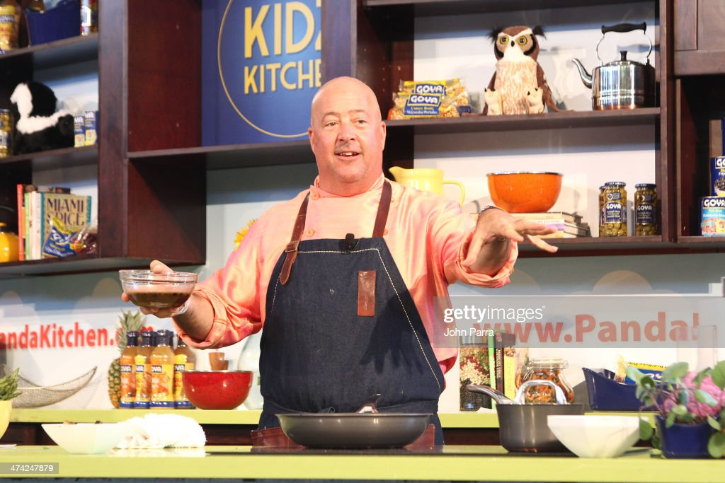 Andrew Zimmern gives a cooking demonstration during Fun And Fit As A Family Sponsored By Carnival Featuring Goya Kidz Kitchen Hosted By Robert Irvine during the Food Network South Beach Wine & Food Festival at Jungle Island on February 22, 2014 in Miami, Florida.