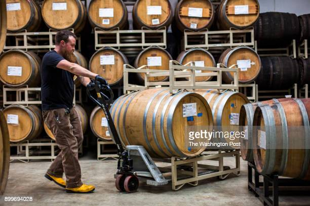 Andrew Zinn lead wood cellarman at Wicked Weed Brewing moves barrels of sour beer at the Wicked Weed Funkatorium in Asheville North Carolina on July...