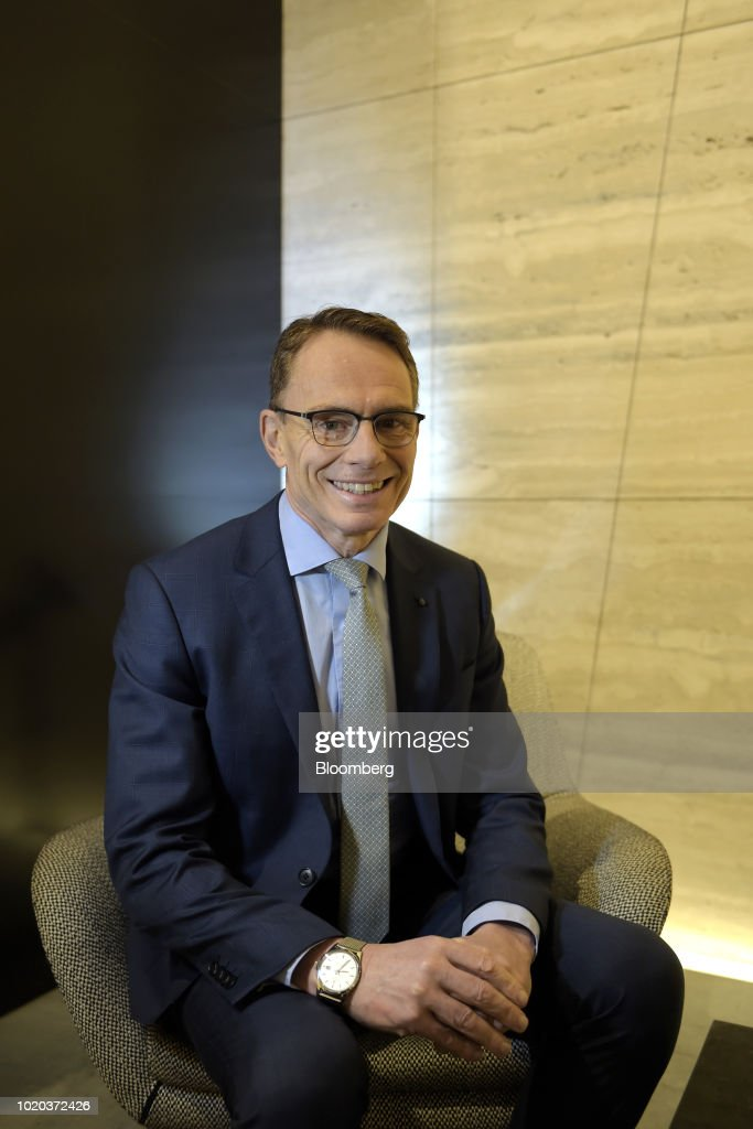 Portraits of BHP Billiton CEO Andrew Mackenzie as Company Reports Full-Year Results