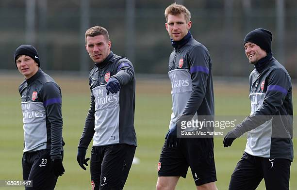Andrey Arshavin, Lukas Podolski, Per Mertesacker and Tomas Rosicky of Arsenal during a training session at London Colney on April 05, 2013 in St...
