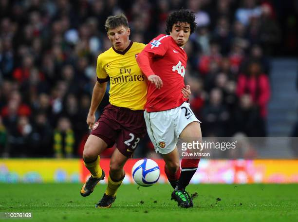 Andrey Arshavin of Arsenal and Fabio Da Silva of Manchester United battle for the ball during the FA Cup sponsored by E.On Sixth Round match between...