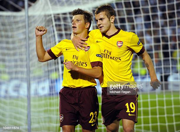 Andrey Arshavin of Arsenal celebrates scoring his team's first goal with Jack Wilshere during the UEFA Champions League Group H match between FK...