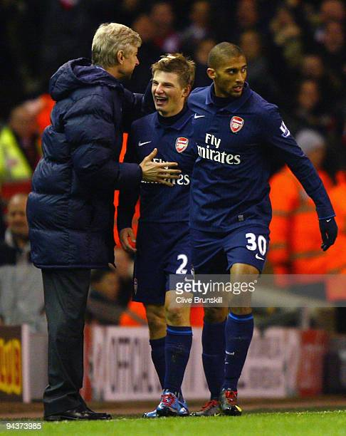 Andrey Arshavin of Arsenal celebrates scoring his team's second goal with Manager Arsene Wenger during the Barclays Premier League match between...