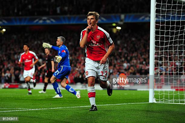 Andrey Arshavin of Arsenal celebrates scoring the second goal during the UEFA Champions League Group H match between Arsenal and Olympiakos at the...
