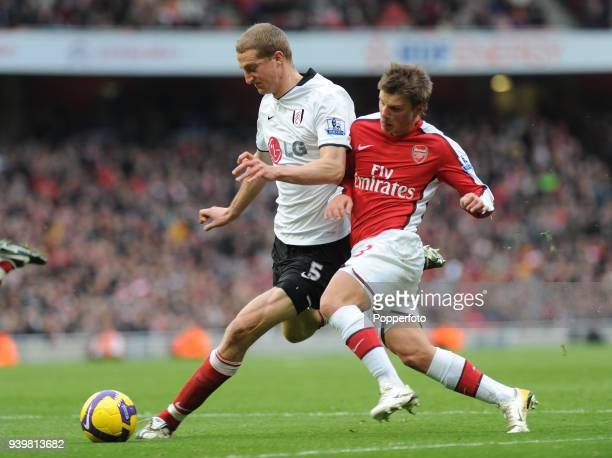 Andrey Arshavin of Arsenal challenges Brede Hangeland of Fulham during the Barclays Premier League match between Arsenal and Fulham at Emirates...