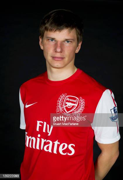 Andrey Arshavin of Arsenal FC poses in the Arsenal home kit for the 2011/2012 season at their London Colney training ground on April 8, 2011 in St....