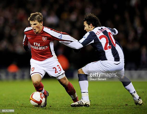 Andrey Arshavin of Arsenal holds off a challenge from Filipe Teixeira of West Bromwich Albion during the Barclays Premier League match between West...