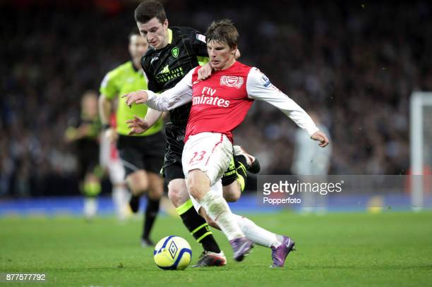Andrey Arshavin of Arsenal holds off the challange by Zac Thompson of Leeds United during a FA Cup 3rd Round match at the Emirates Stadium on January...