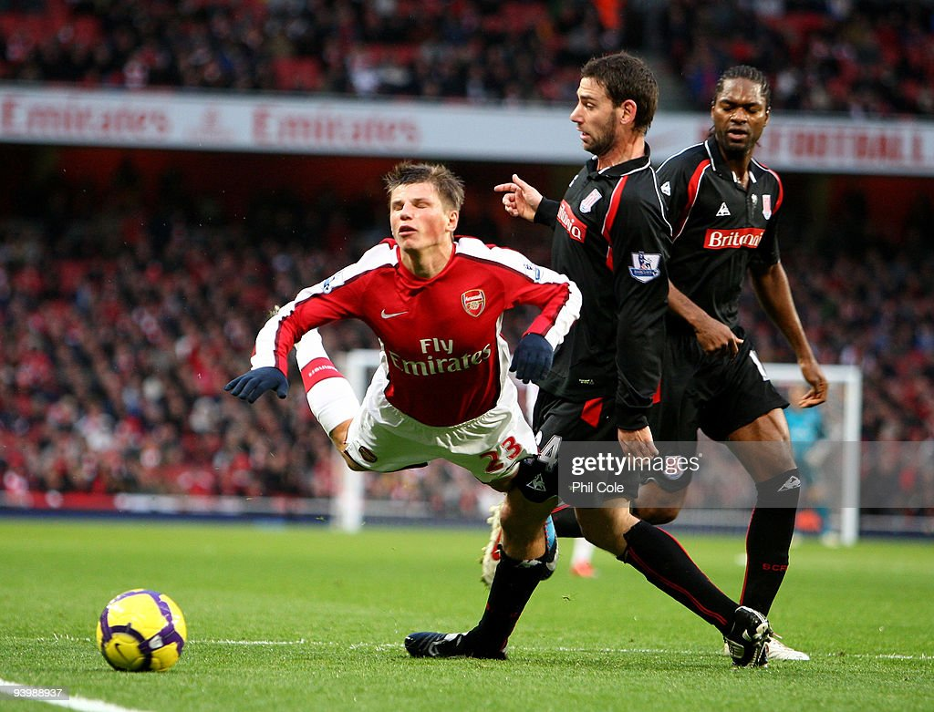Andrey Arshavin of Arsenal is brought down in the Penalty box by Rory Delap of Stoke City during the Barclays Premier League match between Arsenal and Stoke City at the Emirates Stadium on December 5, 2009 in London, England.