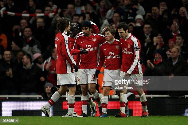 Andrey Arshavin of Arsenal is congratulated after scoring his teams fourth goal during the Barclays Premier League match between Arsenal and Bolton...