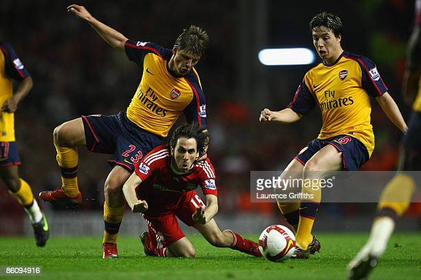 Andrey Arshavin of Arsenal tangles with Yossi Benayoun of Liverpool during the Barclays Premier League match between Liverpool and Arsenal at Anfield...