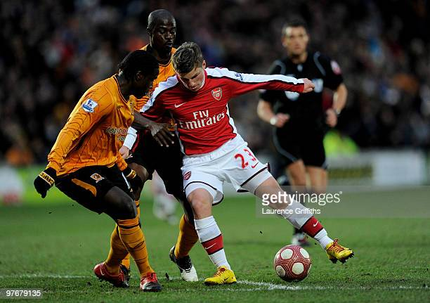 Andrey Arshavin of Arsenal turns Bernard Mendy and George Boateng of Hull City to score the first goal during the Barclays Premier League match...