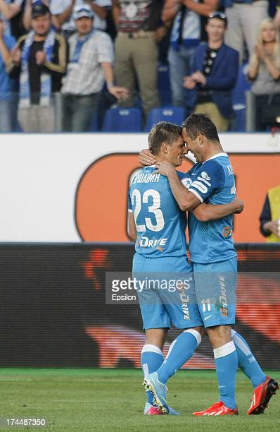 Andrey Arshavin of FC Zenit St Petersburg celebrates with Alexandr Kerzhakov and Anatoliy Tymoschuk after scoring the opening goal during the Russian...