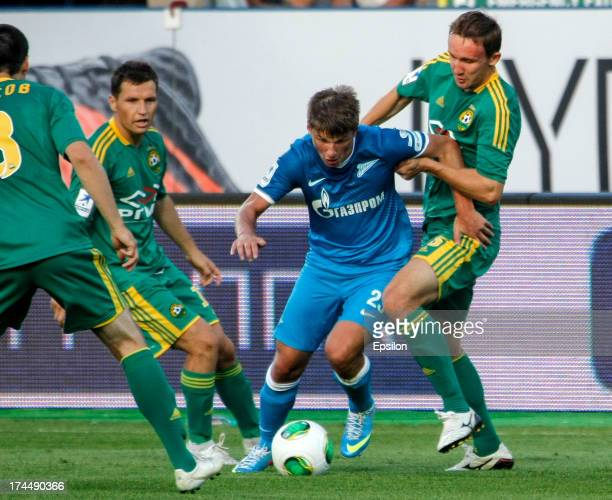 Andrey Arshavin of FC Zenit St Petersburg vies for the ball with Gheorghe Bucur and Aleksei Kozlov of FC Kuban Krasnodar during the Russian Premier...