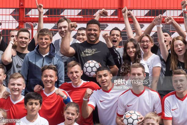 Andrey Arshavin Ronaldo and Evgenia Medvedeva pose with Moscow youngsters at the opening of Box MSK at Gorky Park on June 12 2018 in Moscow Russia...