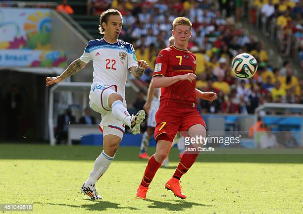 Andrey Eshchenko of Russia and Kevin De Bruyne of Belgium in action during the 2014 FIFA World Cup Brazil Group H match between Belgium and Russia at...