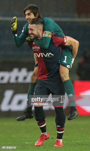 Andrey Galabinov of Genoa CFC celebrates the victory with his teammate Mattia Perin at the end of the serie A match between Genoa CFC and US Sassuolo...