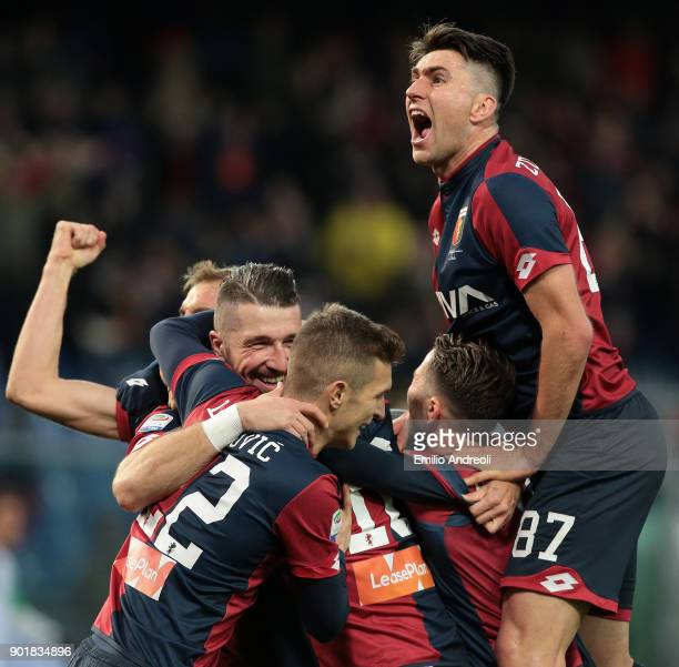 Andrey Galabinov of Genoa CFC celebrates with his teammates after scoring the opening goal during the serie A match between Genoa CFC and US Sassuolo...