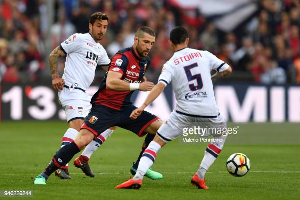 Andrey Galabinov of Genoa CFC in action against Adrian Marius Stoian of FC Crotone during the serie A match between Genoa CFC and FC Crotone at...