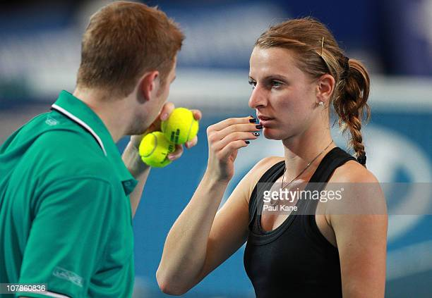 Andrey Golubev and Sesil Karatantcheva of Kazakhstan discuss tactics during their mixed doubles match against Justine Henin and Ruben Bemelmans of...