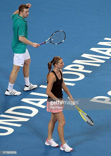 Andrey Golubev and Sesil Karatantcheva of Kazakhstan look on during their mixed doubles match against Justine Henin and Ruben Bemelmans of Belgium on...