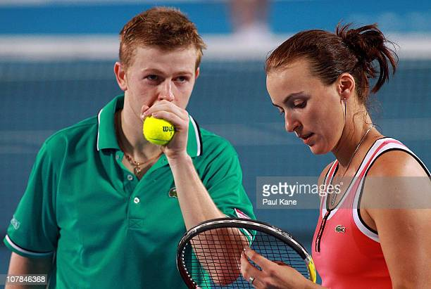 Andrey Golubev and Yaroslava Shvedova of Kazakhstan talk tactics during their mixed doubles match against Novak Djokovic and Ana Ivanovic of Serbia...