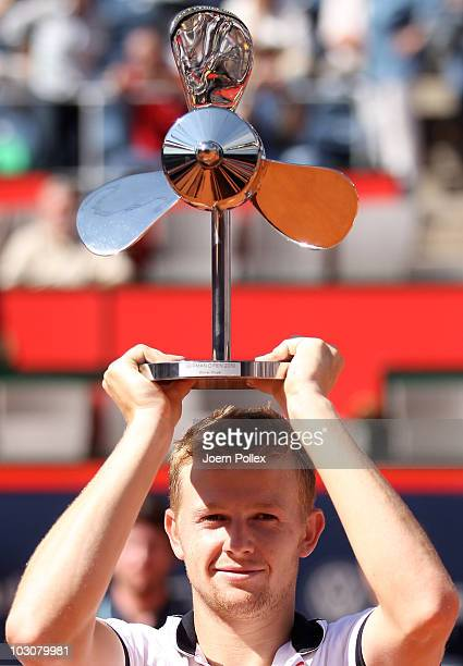 Andrey Golubev of Kazakhstan celebrates with the trophy after winning his final match against Juergen Melzer of Austria during the International...