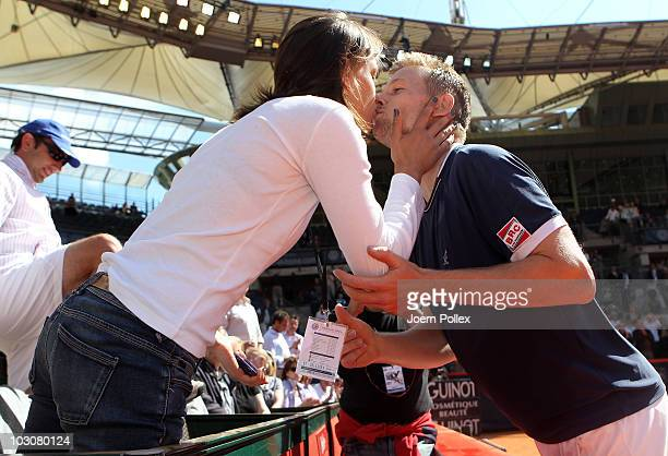 Andrey Golubev of Kazakhstan kisses his girlfriend after winning his final match against Juergen Melzer of Austria during the International German...