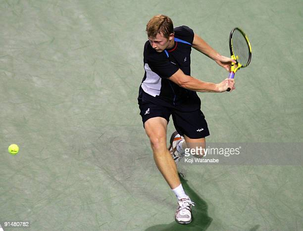 Andrey Golubev of Kazakhstan plays a backhand in his match against Fabrice Santoro of France during day two of the Rakuten Open Tennis tournament at...