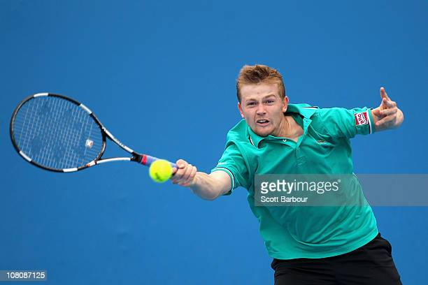 Andrey Golubev of Kazakhstan plays a forehand in his first round match against Grigor Dimitrov of Bulgaria during day one of the 2011 Australian Open...