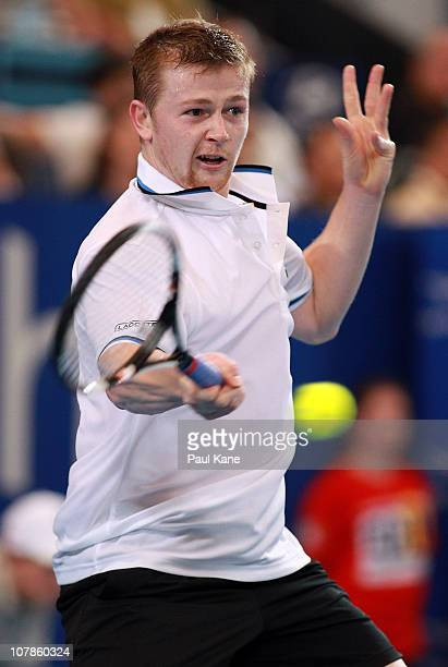 Andrey Golubev of Kazakhstan plays a return shot during his singles match against Ruben Bemelmans of Belgium on day four of the Hopman Cup on January...