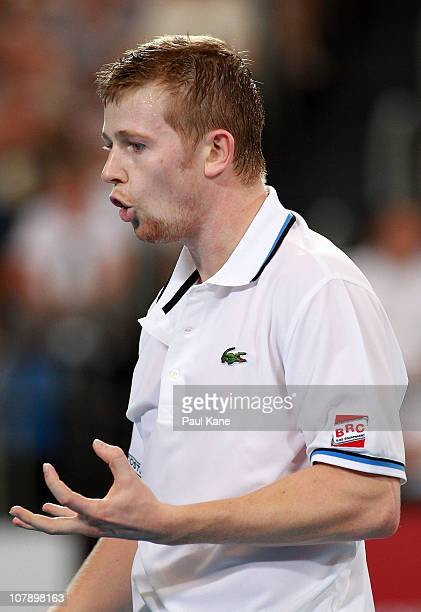 Andrey Golubev of Kazakhstan reacts to missing a shot during his singles match against Lleyton Hewitt of Australia on day six of the Hopman Cup at...