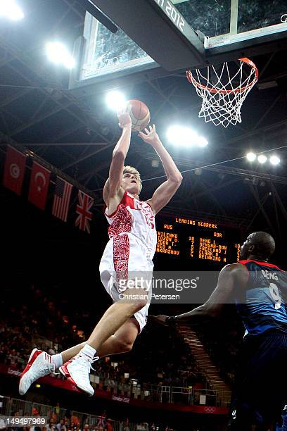 Andrey Kirilenko of Russia dunks the ball against Luol Deng of Great Britain during their Men's Basketball Game on Day 2 of the London 2012 Olympic...