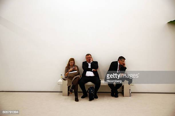 Andrey Kostin chief executive officer of VTB Bank PJSC centre sits on a bench and makes a telephone call between sessions during the World Economic...