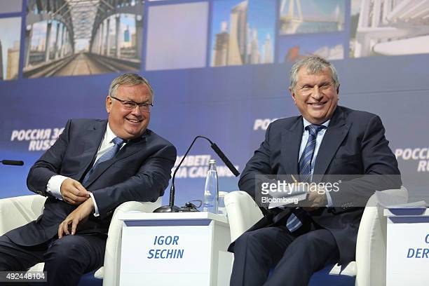 Andrey Kostin chief executive officer of VTB Bank PJSC left and Igor Sechin chief executive officer of Rosneft OJSC react during a panel session on...