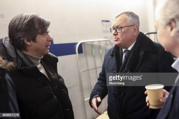 Andrey Kostin chief executive officer of VTB Bank PJSC right speaks with Carlo Messina chief executive officer of Intesa Sanpaolo Spa following a...