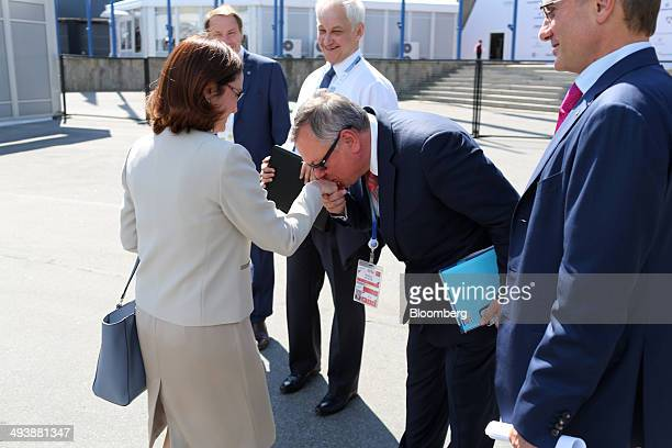 Andrey Kostin chief executive officer of VTB Group center kisses the hand of Elvira Nabiullina chairman of Russia's central bank as Herman Gref...