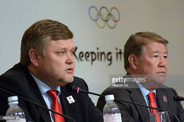Andrey Kryukov Vice Chairman of the host city of the 2022 Winter Olympic Games Bid Committee speaks to the media while Akhmetzhan Yessimov Mayor of...