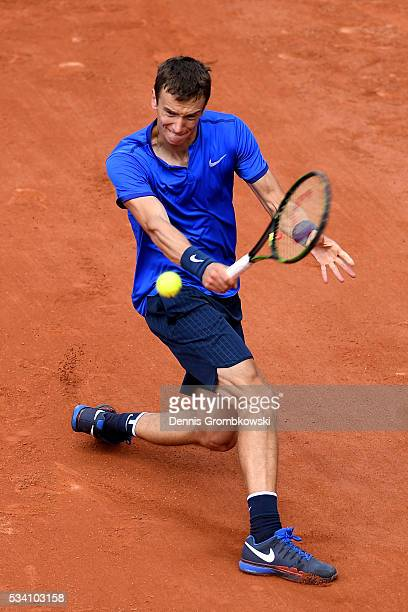Andrey Kuznetsov of Russia plays a backhand during the Men's Singles second round match against Kei Nishikori of Japan at Roland Garros on May 25,...