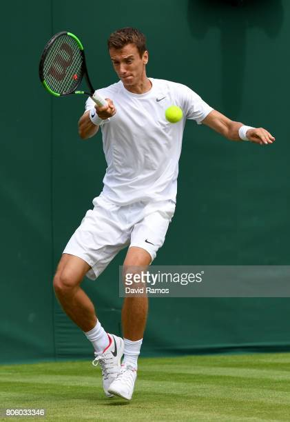 Andrey Kuznetsov of Russia plays a forehand during the Gentlemen's Singles first round match against Karen Khachanov of Russiaon day one of the...