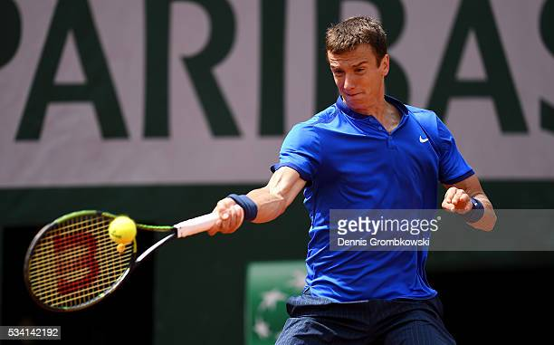Andrey Kuznetsov of Russia plays a forehand during the Men's Singles second round match against Kei Nishikori of Japan at Roland Garros on May 25,...